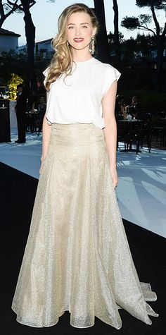 Amber Heard, who was also at the de Grisogono party in Cannes, worked a bodysuit-and-maxi skirt ensemble by Vionnet. Heard's snakeskin Zagliani clutch added a dose of glam to her look while her side swept hair showed off her de Grisogono earrings.
