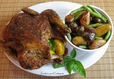 Roasted Chicken with Fingerling Potatoes, Mushrooms and Green Beans by Pam on August 2009 Dutch Oven Roast Chicken, Oven Roasted Whole Chicken, Stuffed Whole Chicken, Fingerling Potatoes, Chicken Potatoes, Green Beans And Potatoes, Dutch Oven Recipes, Stuffed Mushrooms, Stuffed Peppers
