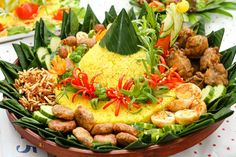 REBLOGGED - Tumpeng, the national Indonesian yellow rice or sago dish, accompanied with various vegetable