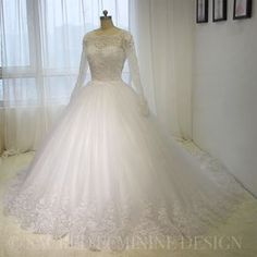 Ball Gown Wedding Dress with tulle skirt, appliquéd and bodice in lace with full sleeves. #BallGown #FullSleeves #Långärmad #Lace #Spets #TulleSkirt #Tyll #WeddingDress #WeddingGown #BridalDress #BridalGown #Brudklänning #Bröllopsklänning #Brudekjole #Bryllup #Kjole #Tailored #Skräddarsydd #SacredFeminineDesign