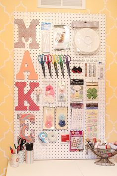 craft room peg board .. scrapbook paper letters .. super cute and crafty organization .. <3