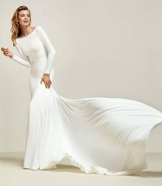 There are very few things I love more than a long sleeved wedding dress, especially when it looks like Drana. This incredibly elegant gown is one of the more simple designs to the naked eye, but with a closer look you can see the intricate detail on the arm cuffs and neckline that really make it something special.