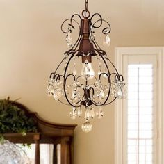 Complement your living room with this elegant crystal chandelier. This indoor chandelier is sure to complement your home with its classy teardrop crystals. Its brushed oak finish is sure to brighten u