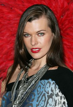 #Milla #Jovovich #Hair - Long Side Part - Dark Brown Layered Look frames her face and shows off her bright green eyes.