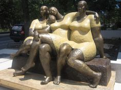 <3 this statue...Statue photo courtesy of DNAinfo. Facade photo by Ulysses