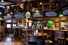 Dubliner Irish Pub. Love the pub table and stools. Also like the green pendants