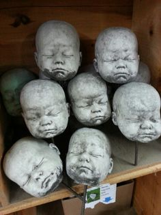 Concrete dolls heads (Call me crazy; I think it would be cool to scatter a bunch of these among some plants) :-)