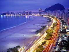 13 Beautiful Places Which You Will be Amazed - The Copacabana Beach in Rio de Janeiro, Brasil Copacabana Beach, Beach At Night, The Beach, Oh The Places You'll Go, Places To Travel, Places To Visit, Travel Destinations, Palm Desert, Dream Vacations
