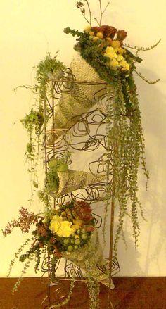 beautiful flower arrangements   This beautiful flower arrangement comprises of three cornucopias, with ...