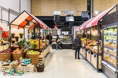 """Each zone of the supermarket aims for a unique atmosphere. We repeat the element of stylized """"village houses"""" with"""
