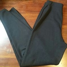 Vintage High-Waistes Cigarette Pants Vintage, knit, high-waisted black cigarette pants with an elastic waist. These pants are very form fitted, but flattering. They are also pretty big for a size small. Pants Trousers