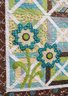 I like the applique on top of the patchwork, and the quilting in the squares