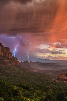 Storm approaches an imminent sunrise or sunset resulting in crazy light and skies at the Coconino National Forest in Sedona, Arizona, USA