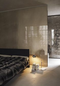 Sleek, simple finishes form a contemporary bedroom space - open and intimate at the same time.