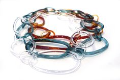 Borosilicate glass necklaces by Jane D'Arensbourg, sterling silver clasp.