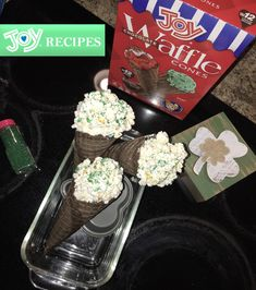 1. Pop the popcorn 2. Mix together popcorn, marshmallow fluff, and chocolate candies 3. scoop into cones 4. Top with sprinkles 5. Enjoy! #bringJOYhome #recipes #St.PatricksDay