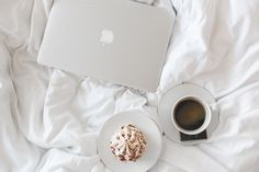 Macbook and cup of coffee in the bed by sanches812 on @creativemarket