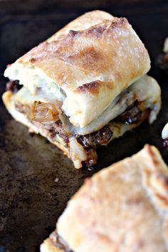 Steak Sandwiches with Caramelized Onions and Provolone Cheese from cravingsofalunatic.com- This easy recipe will be a hit with everyone who tries it. Grilled steak, caramelized onions, provolone cheese, all stacked perfectly on a French baguette. Take a bite! (@CravingsLunatic)