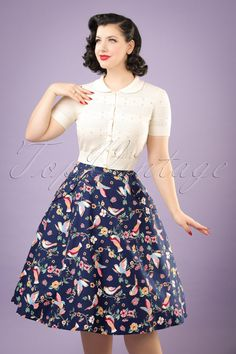 This 50s Theodora Charming Birds Swing Skirt is enchanting!  Prince Charming will be staring at you all the time when wearing this beauty! She's worn at the waist, flares into a full swing skirt and has handy side pockets. Made from a sturdy yet breezy, dark blue cotton blend (doesn't stretch!) with the look of linen and an eyecatching, colourful print of flowers and birds. Pair with a plain top and you're ready to go ;-)    Swing skirt Side poc...