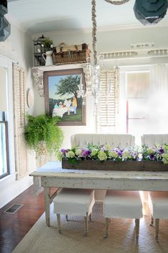 salvaged shutters and farm table. Old corbels and fencing as decor over windows add character.