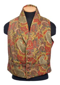 """These two """"paisley"""" vests belonged to Charles Manigault (1795-1874), probably c. 1840. One shows a fairly traditional boteh pattern and is printed while the other is woven with an elaborate repetition of """"exotic"""" temples. The paisley one has corded edging and pocket openings; the temple vest has a woven tape binding on the edges and pockets. The paisley example has covered buttons, the temple one has 8 small brass buttons."""