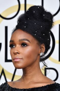 Janelle MonáeThe singer-songwriter keeps proving there is no limit to the accessories you can put in your hair — be it googly eyes or micro-pearls. #refinery29 http://www.refinery29.com/2017/01/135131/golden-globes-2017-best-hair-makeup-photos#slide-3
