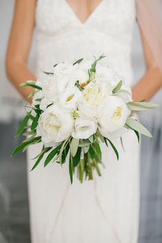 White peony bouquet | Read More: http://www.stylemepretty.com/destination-weddings/2014/08/13/romantic-white-santorini-wedding/ | Photography: Anna Roussos Photography - annaroussos.com