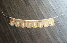 A personal favorite from my Etsy shop https://www.etsy.com/listing/207210404/grateful-burlap-banner-with-colorful