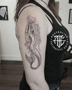 Alluring Goddess Mermaid Arm Tattoo