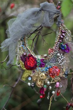 Inspiration- Baroque era, jewel shades, nature, antique textile..Delicate looking statement necklace with shabby chic details and some sparkle & fairytale feel..Made of antique/vintage laces and textiles. Hand sewn, embroidered and beaded- blooms, beading, vintage trims., crystals, findings. - hand dyed veil pieces, antique lace, antique gold metallic passementerie piece ,hand dyed silk blooms, pearls, vintage french ab diamante, ...The necklace has delicate partial silk lining so it is…