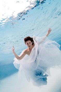 trash the dress after a beach wedding ceremony