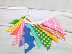 This listing is for the Mini Fabric Bunting. Each flag is approximately 3 inches wide and 4 inches tall. This Mini Fabric Bunting has 11 mini