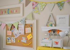 Whimsical Craft Room Decor, corkboard with white fram, bunting flags