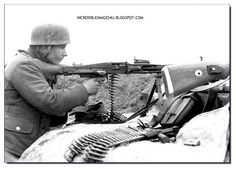 German soldier firing the formidable MG 42 machine gun, one of the finest weapons ever made.