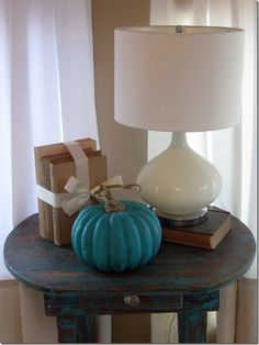 Turquoise painted pumpkin with twine wrapped stem... so simple and yet so striking!