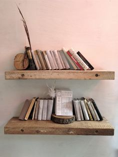 Raw wooden shelves - lag bolts directly into wall studs...why not? Looks great.