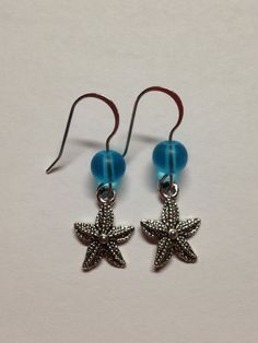 Hey, I found this really awesome Etsy listing at http://www.etsy.com/listing/176837298/homemade-starfish-earrings-sea-glass