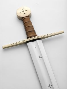 "Arn's sword. Albion modelled it on a type of sword being used at the end of the 1100s. Arn was given his sword by his master, a one-time Templar, Brother Guilbert. The sword is simple, with a long and lean blade, inscribed: 'In Hoc Signo Vinces' on the guard (""In this sign thou shalt conquer""). Arn's sword is the symbol of his mission – of the cross of Christianity, and the battle for good."
