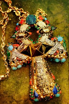 Ankh...a long, heavy chain, a black top or dress and ...  I've a great imagination!
