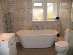 Unique bathroom tile interior design with towel rack - Interior Design Pics