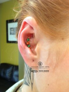 Cienna stopped in for a nostril and conch piercing. She chose this lovely anatometal cluster for her conch. Genuine Topaz Poppy and Rainforest gems, handset in implant grade titanium anodized copper. Great choice, Cienna. Thank you!