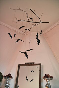 Paper Bats....we could do these from the celing in the dining hall...