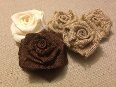 Burlap Roses --- strip of burlap, glue gun; fold burlap in half lengthwise, roll burlap tight multiple times (for the center) and then begin to twist the burlap away from the centre until out of burlap, glue. Done.