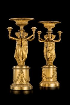 A pair of Empire bronze doré candelabra by Pierre-Philippe Thomire, h 55 cm.