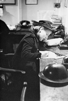 A member of the Auxiliary Fire Service (AFS) takes a call during a night of bombing during the Blitz, London, 1941. Original publication: Picture Post - 587 - Fire-Fighters! - pub. 1st February 1941 (Photo by Bert Hardy/Picture Post/Hulton Archive/Getty Images)