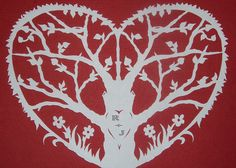 Love Tree, paper cutting.  To make your own, blow this up fold paper in half, and cut one side.  Cut out the same spaces that have red in them.  Use any paper you want!