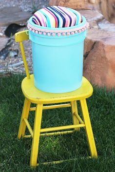 bucket seat for camping (add a shower curtain or other plastic cover to the fabric/foam seat to waterproof it!)  I would love to let the girls make these this year! They can fit camping stuff inside and also use it as a campfire chair!