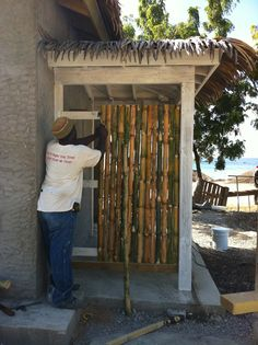 Stalks of bamboo were locally sourced, cut, and dried to make a screen for the Public Toilet Block's outdoor shower in Little Bay.