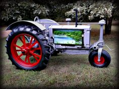 Antique tractor as flat screen TV stand