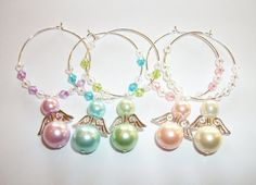Items similar to ANGELS - Angel Glass Pearl Wine Glass Charms, Party Accessory, Ladies Hen Wine Charms, Love Anniversary Wedding Wine Charms on Etsy Wine Bottle Charms, Bead Bottle, Bottle Art, Wine Glass Markers, Wine Glass Crafts, Bottle Crafts, Decorated Wine Glasses, Painted Wine Glasses, Bride Wine Glass